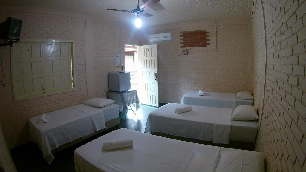 A bed or beds in a room at Pousada Pantaneira