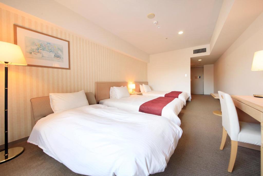 Tempat tidur dalam kamar di Quintessa Hotel Sasebo