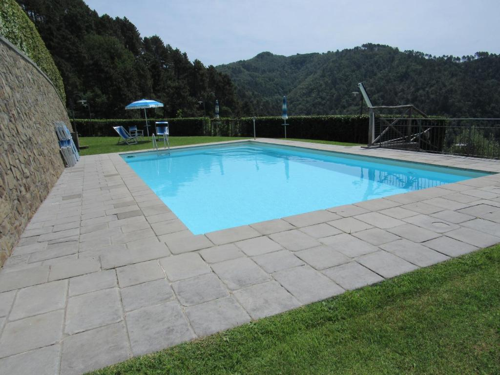 The swimming pool at or near Le Cerrete