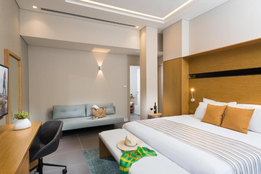 מיטה או מיטות בחדר ב-מלון אואזיס ים המלח
