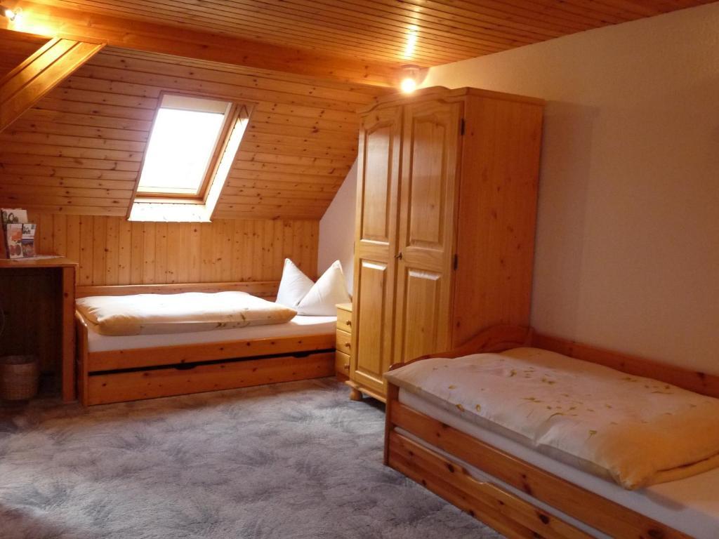 Ein Bett oder Betten in einem Zimmer der Unterkunft Pension a la Kleinert