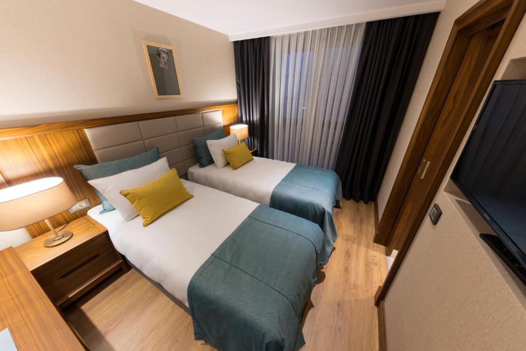 Кровать или кровати в номере Endless Art Hotel-Special Category