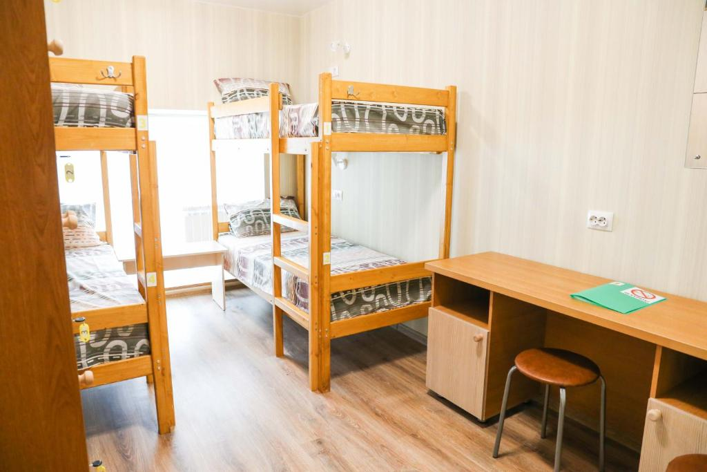 A bunk bed or bunk beds in a room at Hostel Ujniy