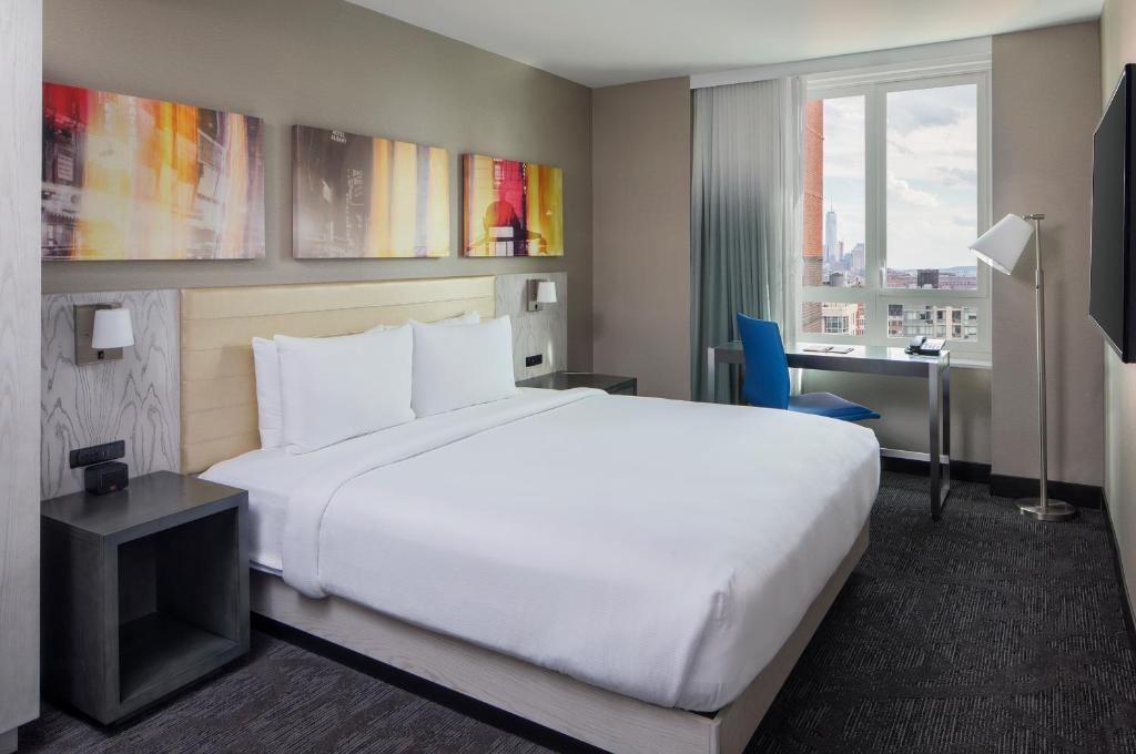 A bed or beds in a room at Doubletree By Hilton New York Times Square West