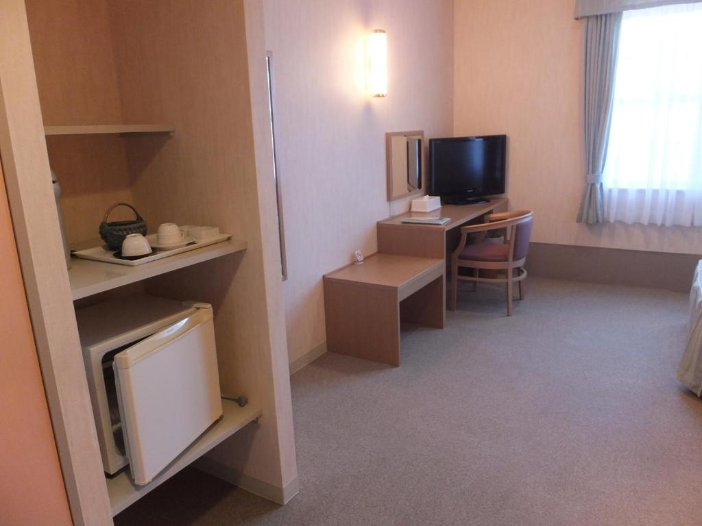A television and/or entertainment center at Petit Hotel Pure Field Kaze Youbi