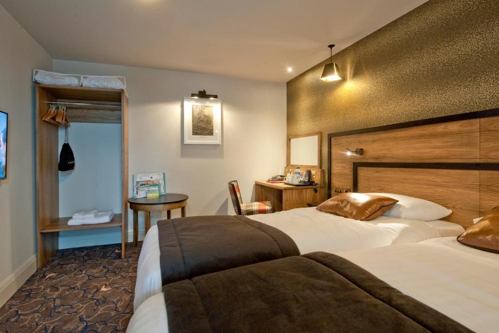 Łóżko lub łóżka w pokoju w obiekcie The Saltoun Inn Wetherspoon
