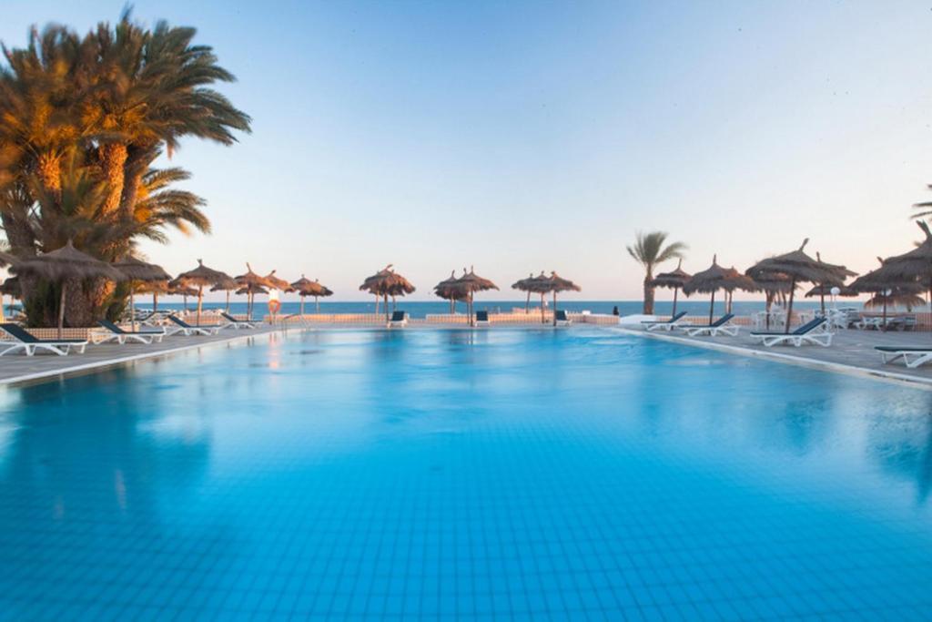 The swimming pool at or near El Mouradi Djerba Menzel