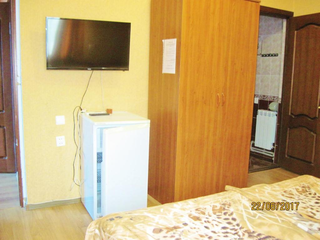A television and/or entertainment center at Liana Guest House