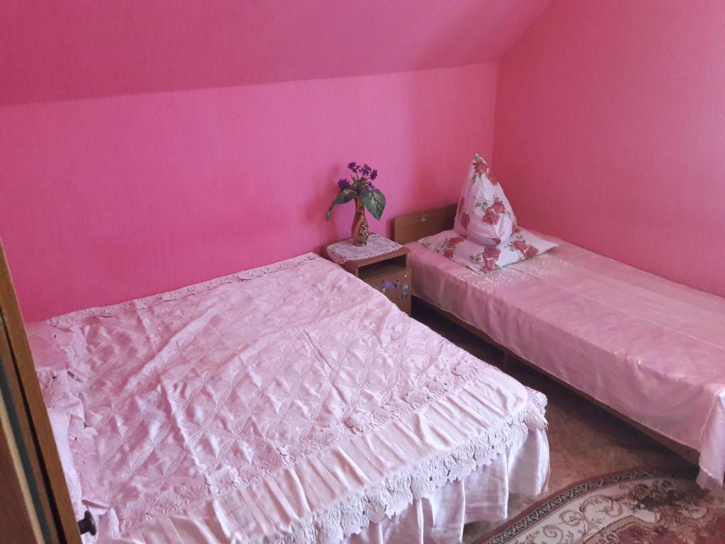 Кровать или кровати в номере Guest house at Krymskaya