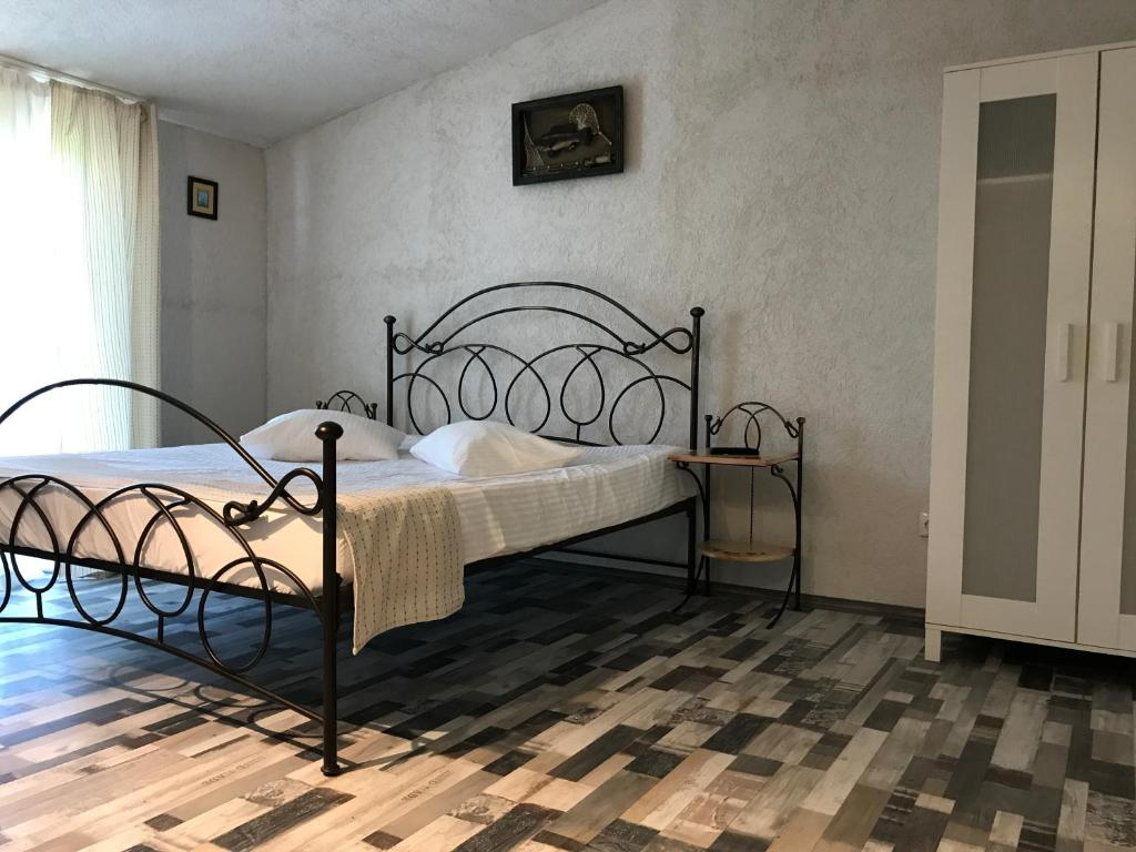 A bed or beds in a room at Vila Sarah