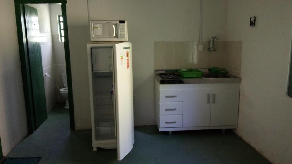 A kitchen or kitchenette at Pousada Fazenda Sant´ana