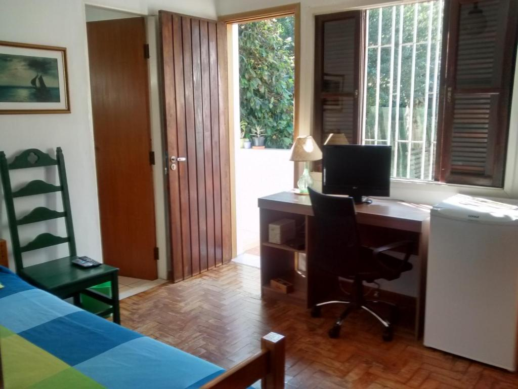 A television and/or entertainment center at Sunny Interlagos Suite