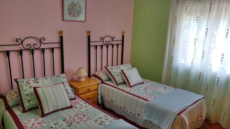 Cama o camas de una habitación en Apartamentos La Flor