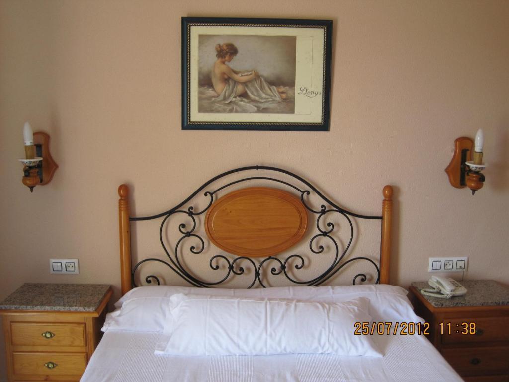 Cama o camas de una habitación en Hotel Caballo Negro