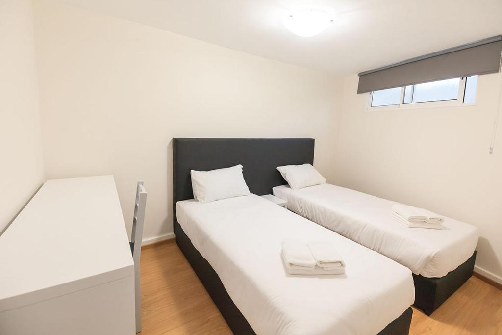 Cama o camas de una habitación en Divino´s Hostel