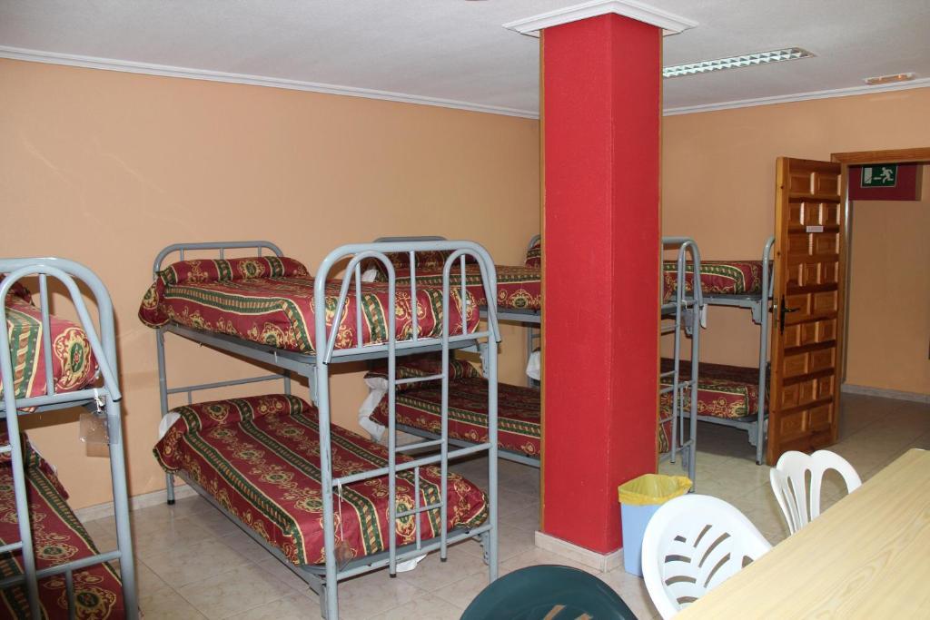 A bunk bed or bunk beds in a room at Albergue Juvenil Salamanca