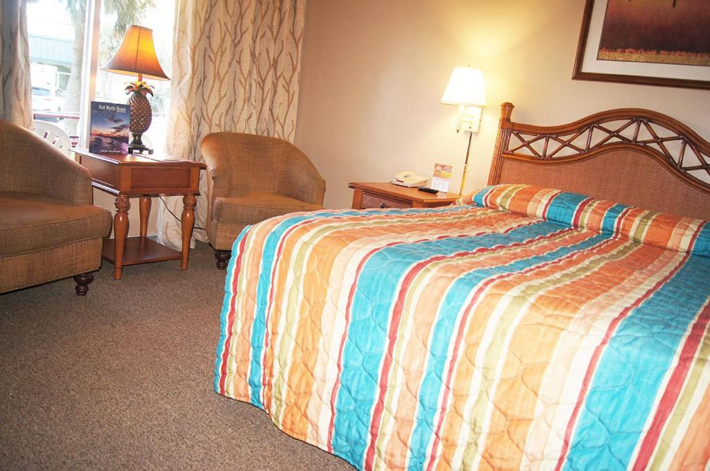 A bed or beds in a room at Oceanfront Viking Motel