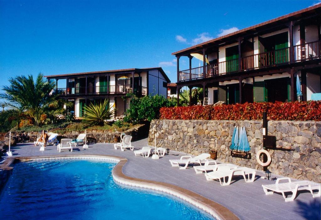 The swimming pool at or near Apartamentos Santa Ana - Adults Only