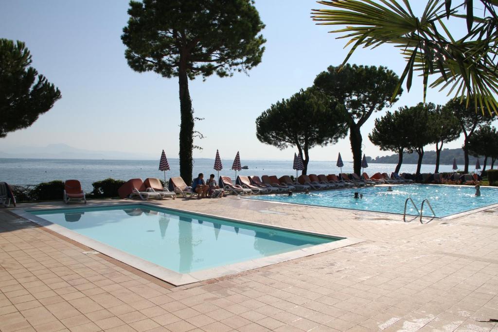 The swimming pool at or near Le Corti Del Lago