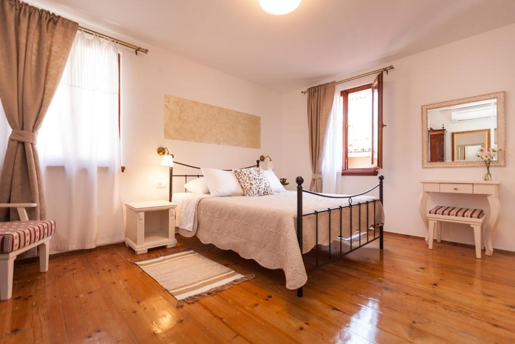 A bed or beds in a room at Guesthouse Casa Vittoria