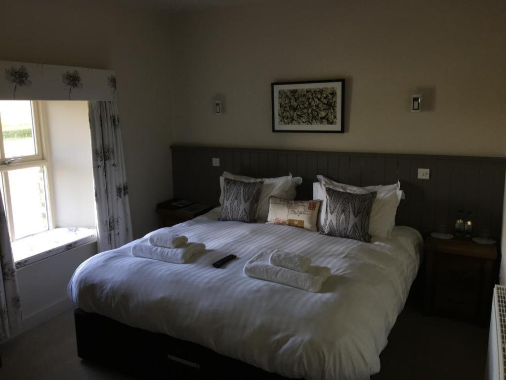 Katil atau katil-katil dalam bilik di Red Well Inn