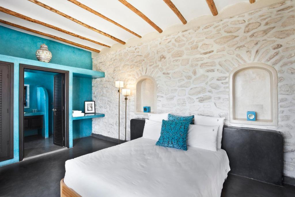 A bed or beds in a room at Le Douar des Arganiers