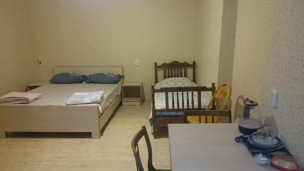 A bed or beds in a room at Guest House Econom
