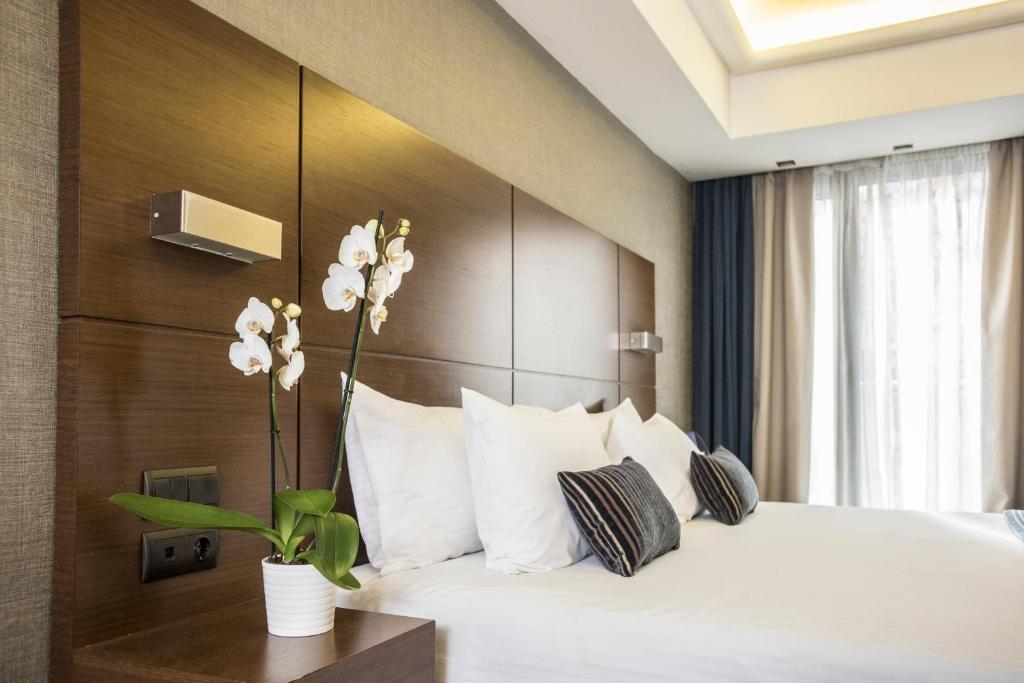 Ein Bett oder Betten in einem Zimmer der Unterkunft Anatolia Hotel