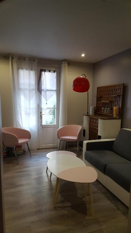 Coin salon dans l'établissement Home St. Germain