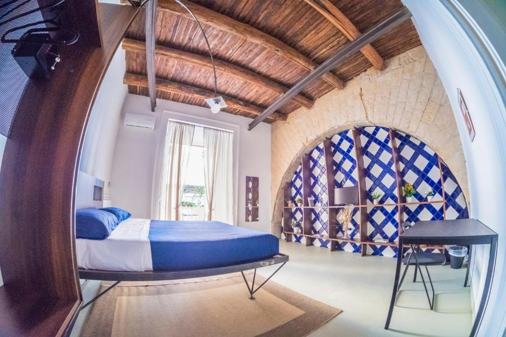 A bed or beds in a room at Per Amor Duomo