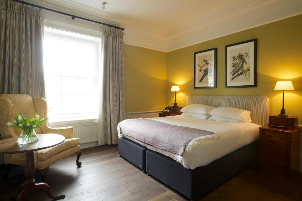 A bed or beds in a room at The Manor at Sway – Hotel, Restaurant and Gardens
