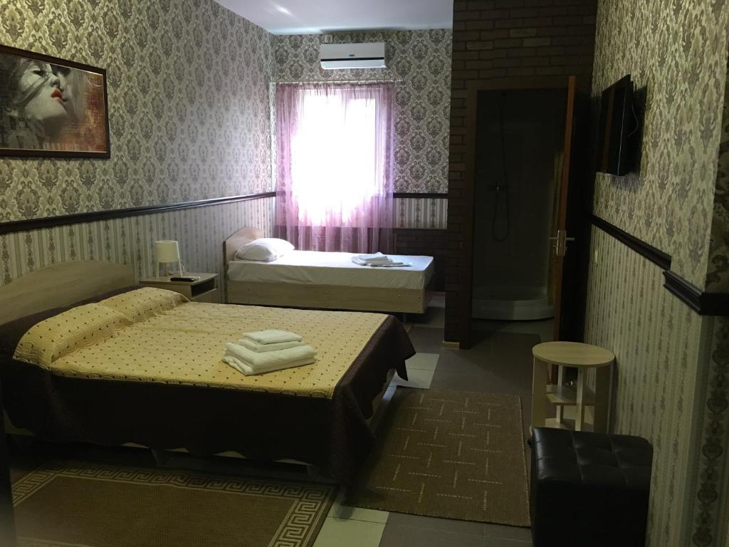 A bed or beds in a room at Leon Hotel