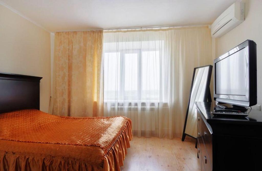 Телевизор и/или развлекательный центр в Apartment near Fabri on Lenina