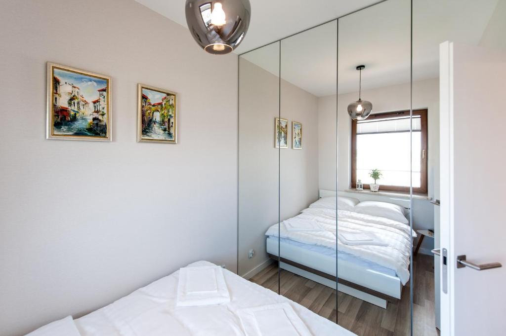 Lova arba lovos apgyvendinimo įstaigoje Apartamenty Grzegórzki Park