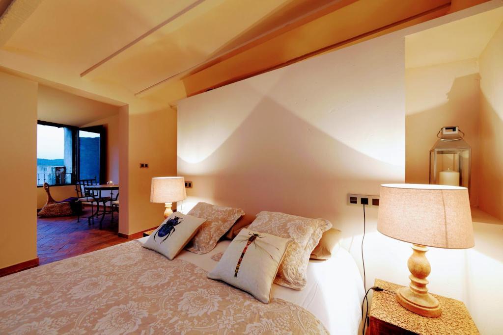 Posteľ alebo postele v izbe v ubytovaní Dalt Vila