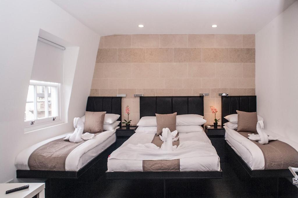 Postel nebo postele na pokoji v ubytování MStay Hyde Park Hotel