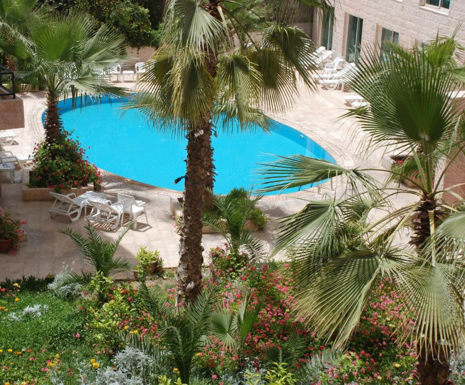 A view of the pool at Petra Palace Hotel or nearby