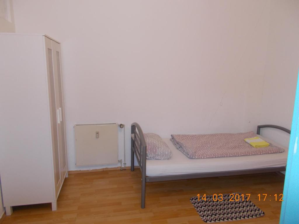 A bed or beds in a room at A&S Hostel