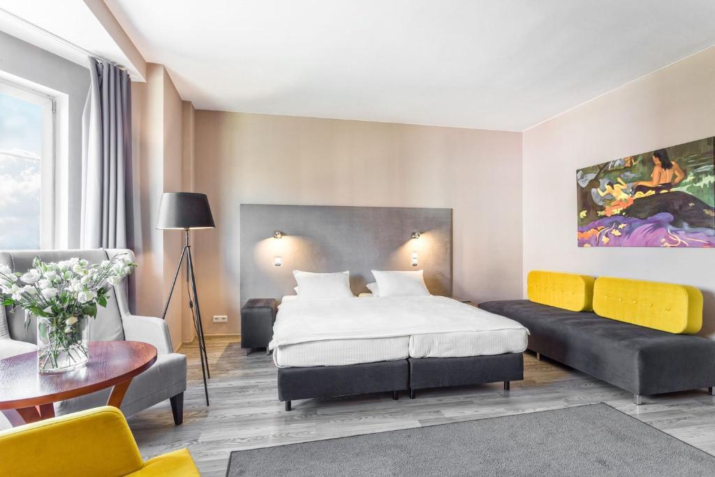 Ein Bett oder Betten in einem Zimmer der Unterkunft Hotel Kaliski