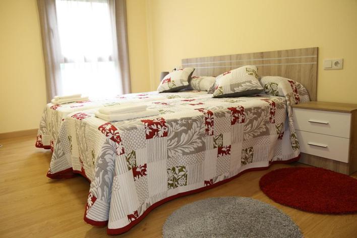 Cama o camas de una habitación en Alojamiento Caldas de Reis