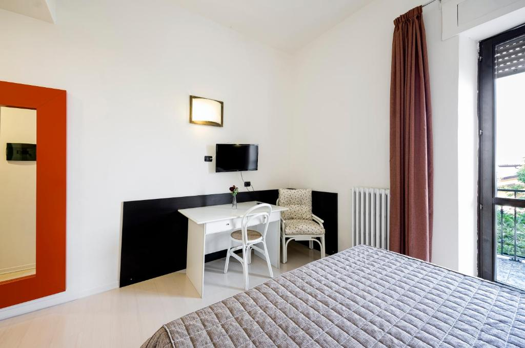 Letto o letti in una camera di Hotel Colucci
