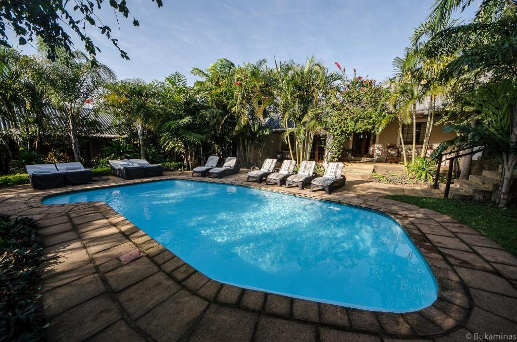 The swimming pool at or near Lidiko Lodge