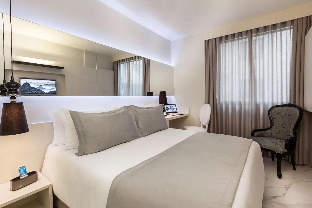 En eller flere senger på et rom på BEST WESTERN Plus Copacabana Design Hotel
