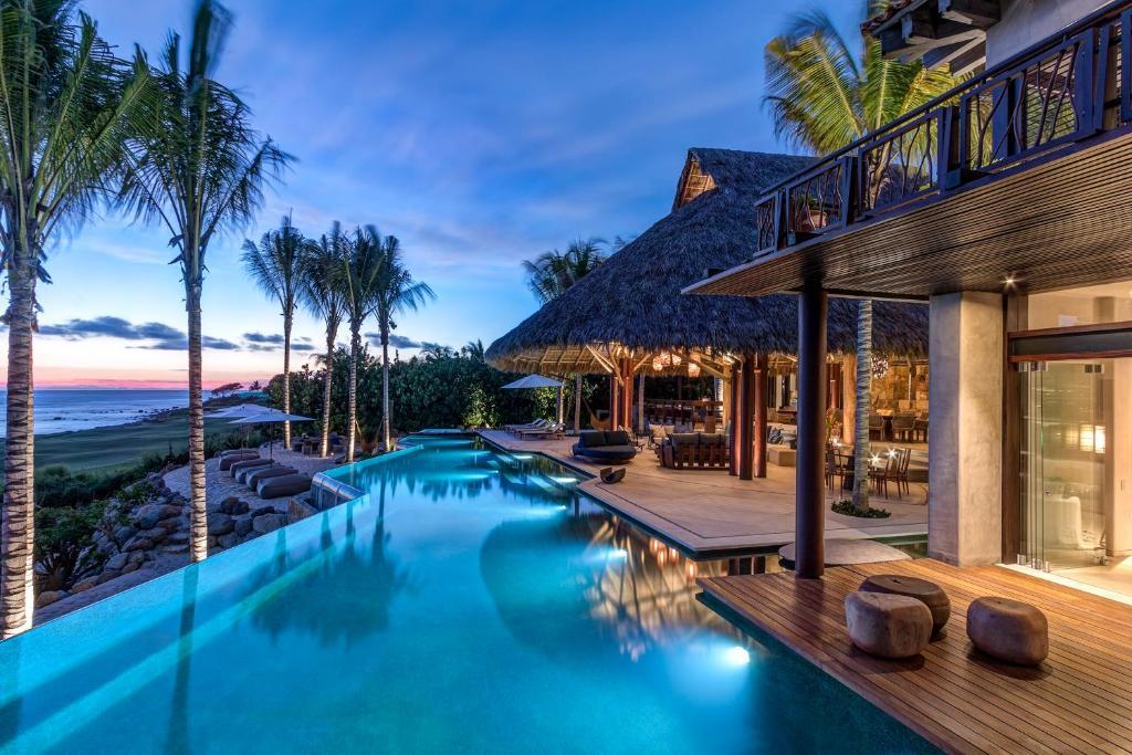 The swimming pool at or near Casa Koko