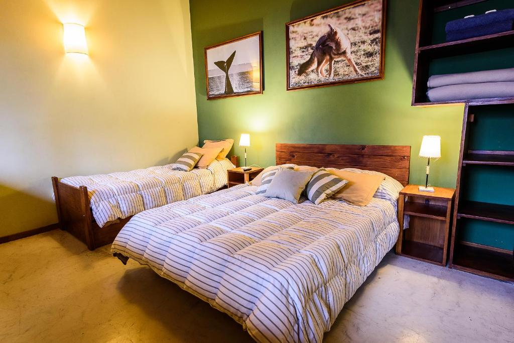 A bed or beds in a room at La Tosca Hostel