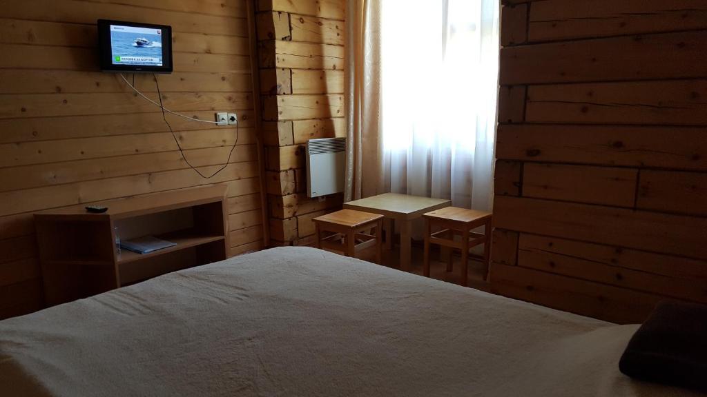 Кровать или кровати в номере Ару-Кёль