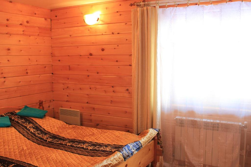 A bed or beds in a room at Guest house Aru-Kiol'