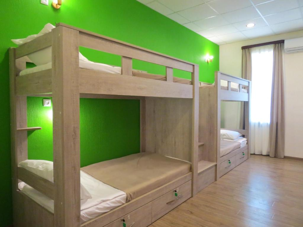 A bunk bed or bunk beds in a room at Hostel Your Home