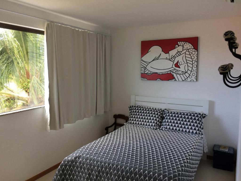 Cama ou camas em um quarto em Solaris Village