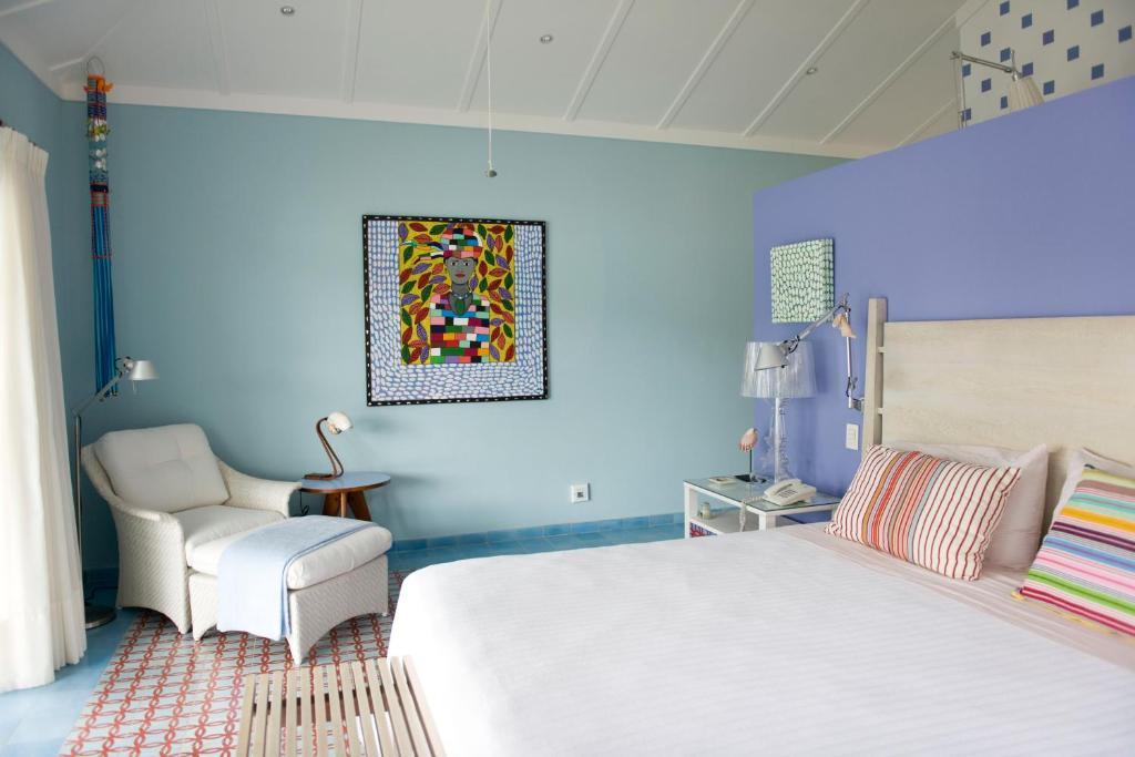 A bed or beds in a room at El Otro Lado - Private Retreat